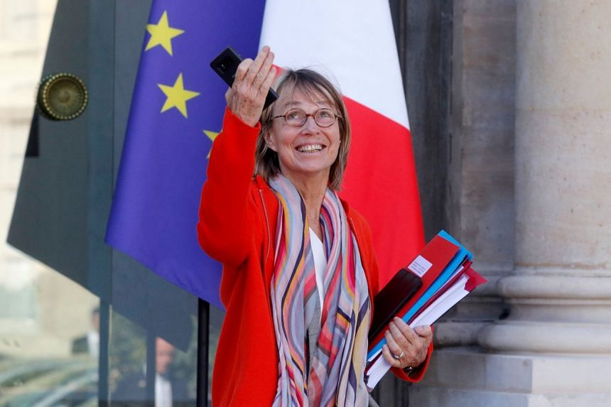 """Francoise Nyssen leaves the Elysee Palace in Paris on Oct 10, 2018. She defended the draft laws saying they """"in no way"""" violated the right to free speech."""