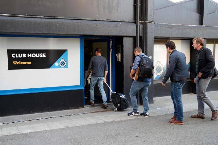 Investigators entering the premises of Belgium's domestic champions Club Bruges in Bruges on October 10, 2018, where they undertook searches as part of a larger investigation on tax evasion, money laundering and possible match-fixing. A total of 44 s