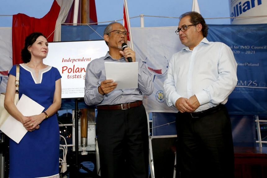 Minister for the Environment and Water Resources Masagos Zulkifli, flanked by Polish ambassador Magdalena Bogdziewicz and Minister of Maritime Economy and Inland Navigation Marek Grobarczy, speaks on board the Dar Mlodziezy on Oct 9, 2018.
