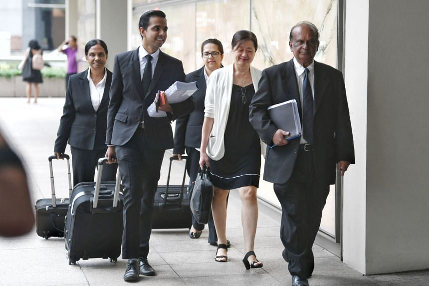 Ms How Weng Fan (second from right) of FM Services & Solutions arriving at the Supreme Court with her legal team on Oct 10, 2018.