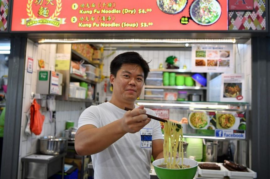 Former part-time bartender Kwan Yee Liang, who sells handmade noodles, runs the other incubation stall at Block 163 Bukit Merah Central Food Centre. He now earns about $3,000 a month.