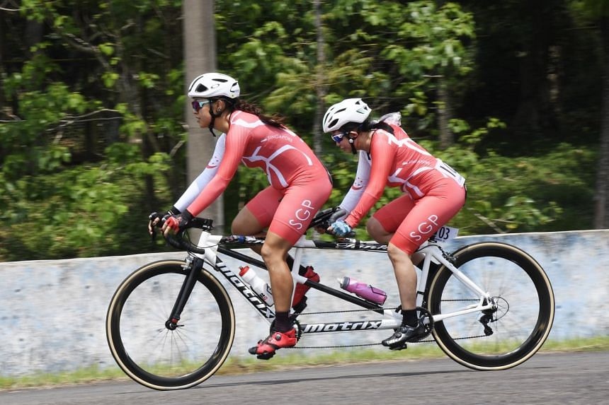 Singapore para-cyclist Emily Lee and pilot Sarah Tan in the women's 72km (18 Laps) road race (B). They finished third among five pairs in 2hr 25min 33sec) to win the bronze.