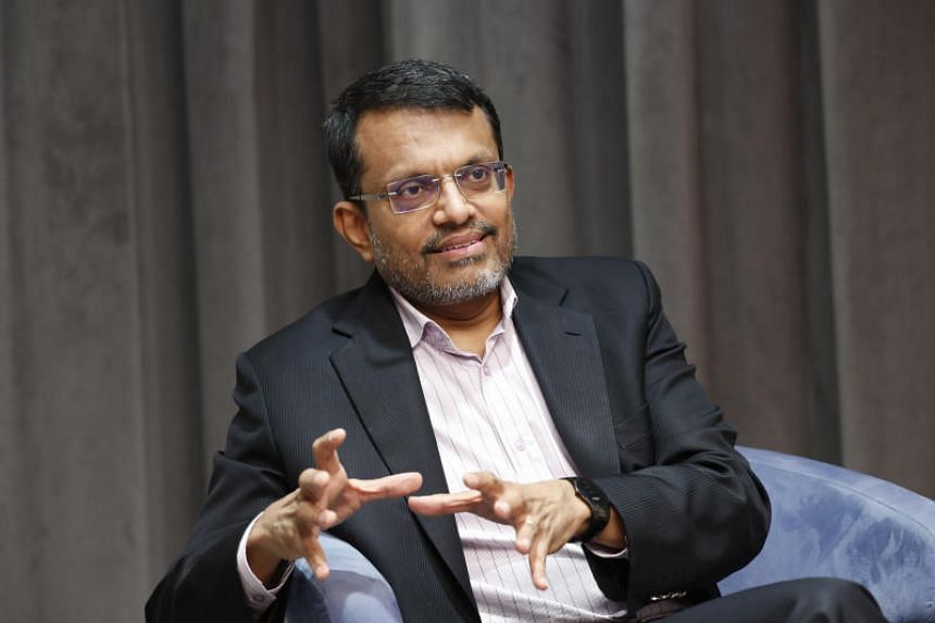 """MAS managing director Ravi Menon said he's taking a balanced view, pointing to still solid growth in Asia, despite an expected slowdown in China, and a US economy that's """"chugging along""""."""
