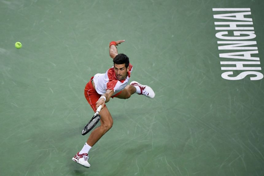 Djokovic hits a return against France's Jeremy Chardy.