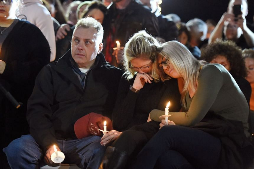 Relatives of the limousine accident victims hold a candlelight vigil in Amsterdam, New York, Oct 8, 2018.