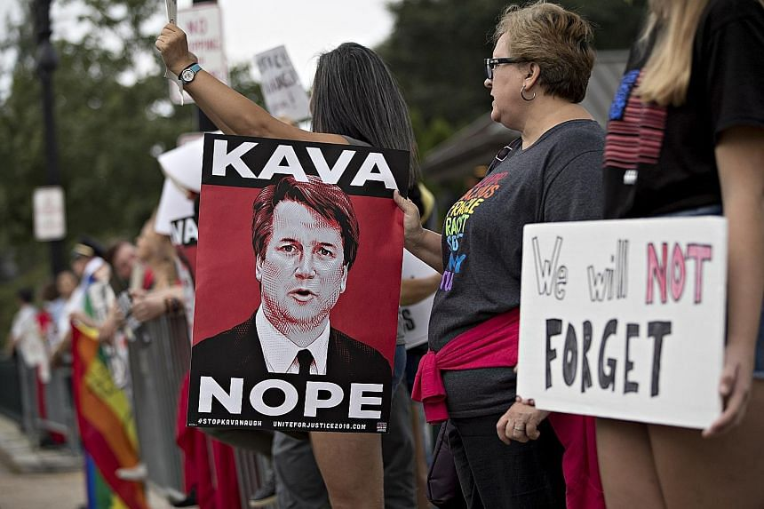 Demonstrators opposed to the appointment of Supreme Court Justice Brett Kavanaugh outside the high court in Washington on Tuesday.