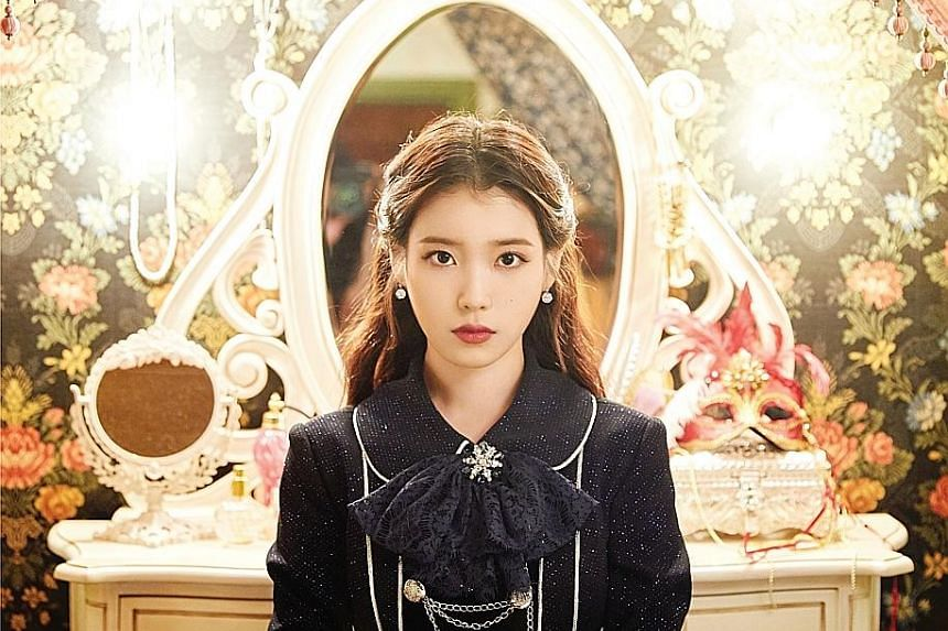 Singer IU (above) and boyband BTS (left, performing at the Citi Field stadium in New York) will hold concerts in Singapore on Dec 15 and Jan 19 respectively.