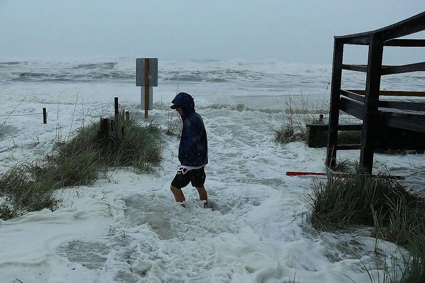 Waves crashing as the outer bands of Hurricane Michael arrived at Panama City Beach, Florida, yesterday. The hurricane could possibly unleash waves as high as 4m when it makes landfall on Florida's Panhandle.