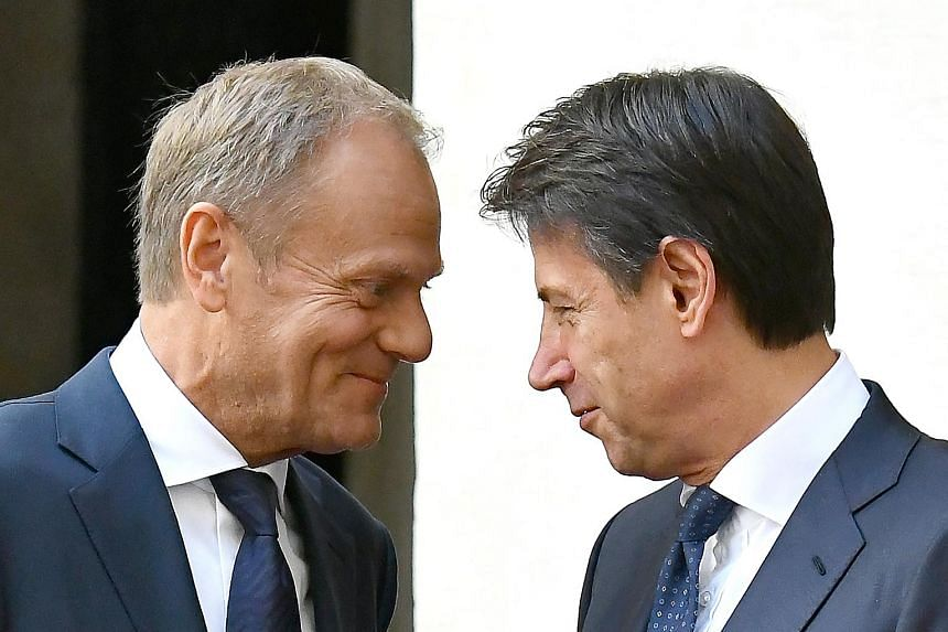 European Union President Donald Tusk (far left) with Italian Prime Minister Giuseppe Conte in Rome last month. Rome seems to have no inclination to adhere to the rules of the euro zone. But until the elections for the European Parliament next May, Br