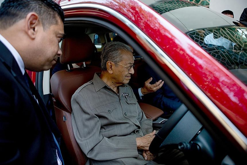 Prime Minister Mahathir Mohamad in a Proton SUV. He started Proton Holdings in the 1980s during his previous tenure, but the brand was later privatised. The new car has been described as competing in a market beyond Malaysia.