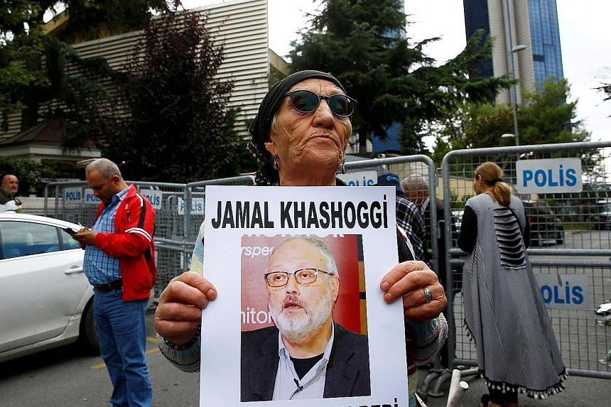 A protester holding a picture of missing Saudi journalist Jamal Khashoggi outside the Saudi consulate in Istanbul on Tuesday.