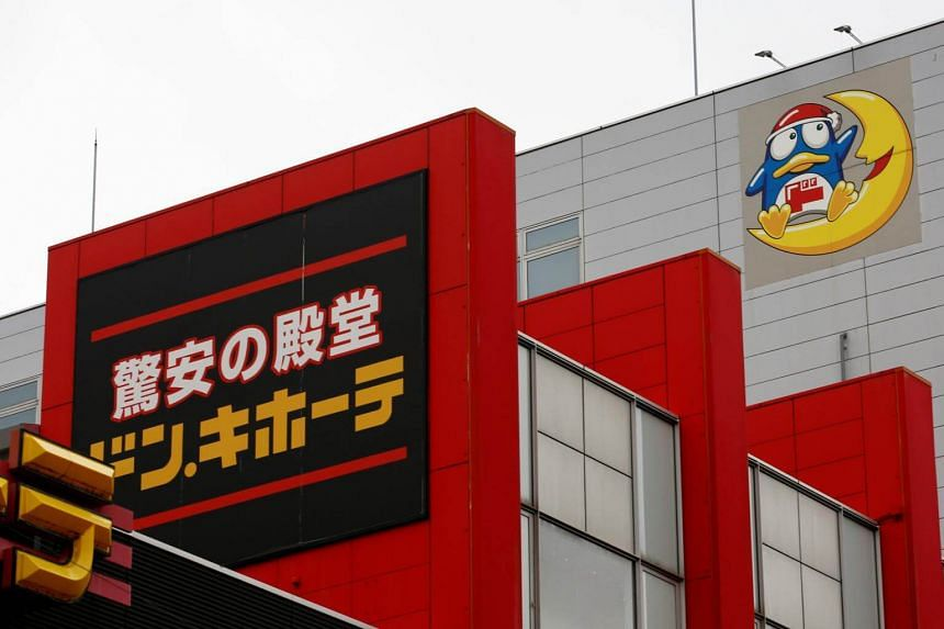 The logo of Japanese discount retailer DonQuijote Holdings is pictured at one of its stores in Tokyo, Japan, on June 18, 2018.