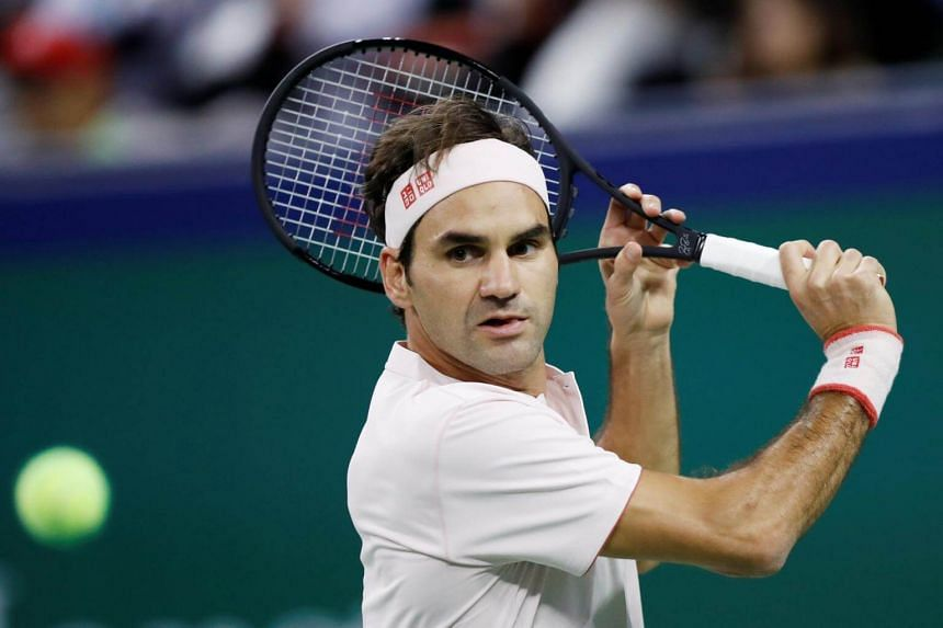 Roger Federer of Switzerland hits a return during his men's singles second round match at the Shanghai Masters tennis tournament, on Oct 10, 2018.