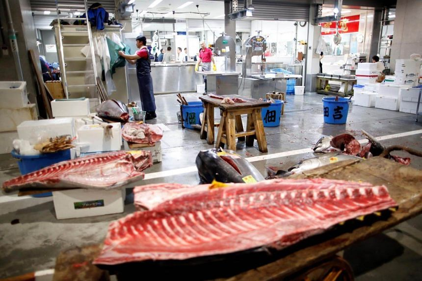 Tuna meat is seen at a wholesalers' area on the opening day of the new Toyosu fish market in Tokyo, on Oct 11, 2018.