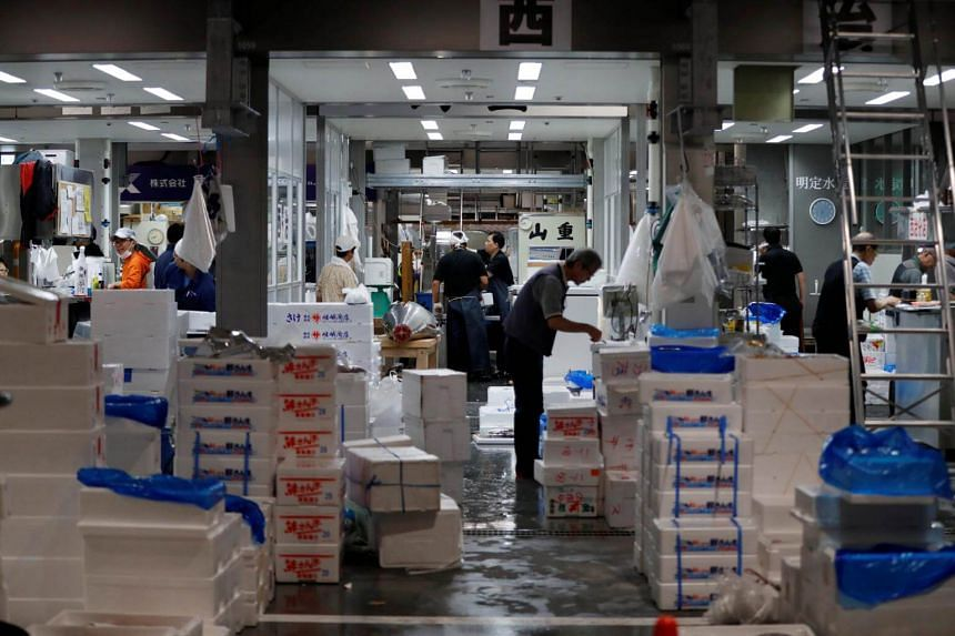 A fishmonger works at a wholesalers' area on the opening day of the new Toyosu fish market in Tokyo, on Oct 11, 2018.