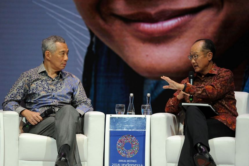 """Prime Minister Lee Hsien Loong and World Bank president Jim Yong Kim at the Human Capital Summit in Bali on Oct 11, 2018. Mr Kim said that Singapore was """"not a country full of crazy rich Asians 50 years ago""""."""