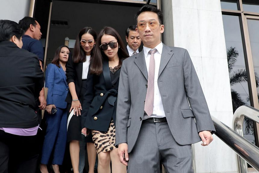 Panthongtae Shinawatra went to the attorney general's office to face the indictment, accompanied by both his sisters and many senior members of the Thaksin-backed Puea Thai Party.