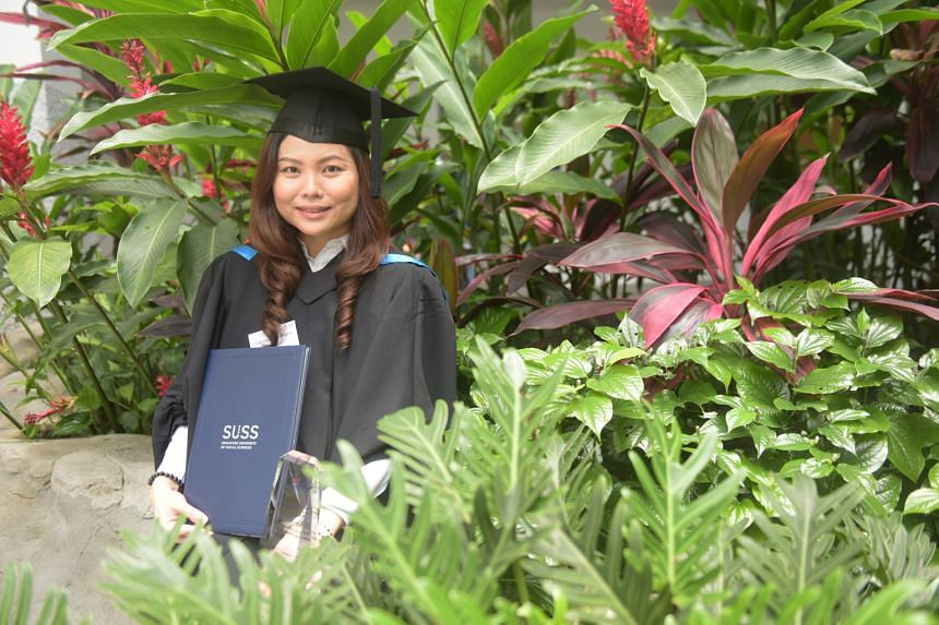 Ms Angela Goh, who received her Bachelor of Science in Business Analytics degree yesterday after three years of part-time studies at SUSS, credits her husband for his support. She says he took charge of supervising their children and helping them wit