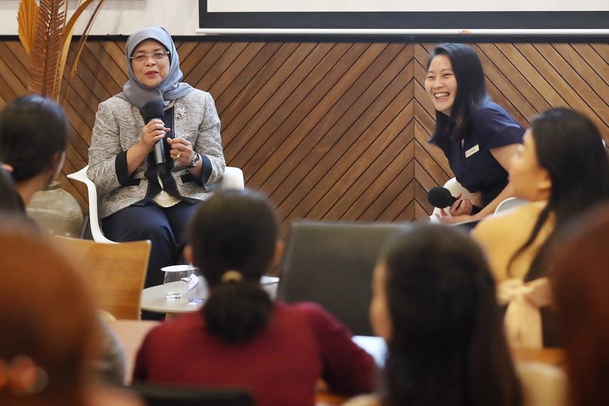 President Halimah Yacob addressing 48 women from the Young Women's Leadership Connection (YWLC) at the Singapore Management University yesterday on the topics of career and leadership. The moderator for the session was Ms Goh Xin Ying (right), YWLC's