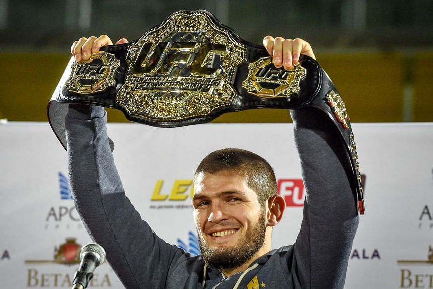 "A joyous UFC lightweight champion Khabib Nurmagomedov upon his return to Makhachkala, Dagestan, on Monday. The vanquished Conor McGregor wants a rematch, but he has to serve a ""medical suspension"", while the Russian is set to be banned for a period b"
