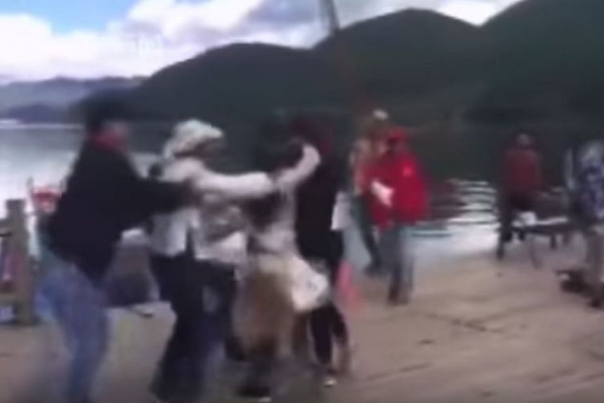 Footage of the incident, which began circulating online on the same day as the incident, shows the two parties tussling with each other as one person wields a wooden oar and tries to hit another person with it.