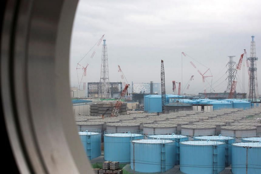 Storage tanks for contaminated water at Tokyo Electric Power's Fukushima Daiichi nuclear power plant in Japan. The firm said the water still contains detectable levels of potentially harmful radioactive particles.