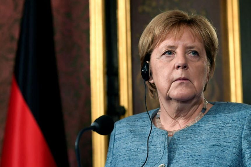 German Chancellor Angela Merkel urged the conservative parties to end their infighting before the Bavaria vote. Divisions between the parties have widened further after an inconclusive national election in March.