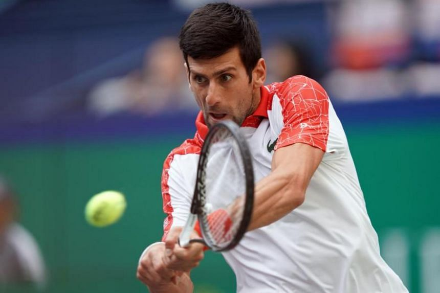 Novak Djokovic (pictured) of Serbia hits a return against Italy's Marco Cecchinato during their men's singles third round match at the Shanghai Masters tennis tournament on Oct 11, 2018.