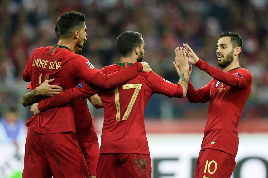 Portugal's Rafa, Bernardo Silva and team mates celebrate their second goal.