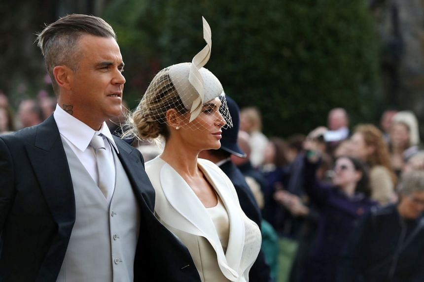 British singer Robbie Williams and his wife Ayda Field arrive at St George's Chapel for Princess Eugenie's wedding to Mr Jack Brooksbank.