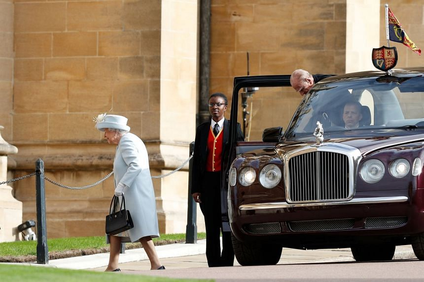 Britain's Queen Elizabeth and Prince Philip arrive at St George's Chapel for Princess Eugenie's wedding to Mr Jack Brooksbank.