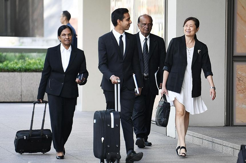 (From right) FMSS' Ms How Weng Fan with her lawyer Leslie Netto and legal team at the Supreme Court yesterday. On day five of a multimillion-dollar civil suit to recover alleged excess payments to FMSS, Mr Netto insisted that AHTC's town councillors