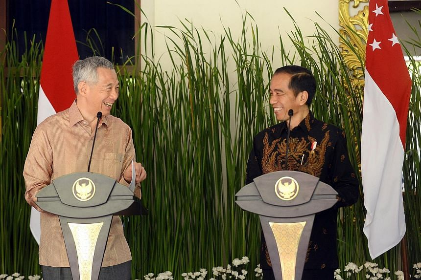 Prime Minister Lee Hsien Loong and Indonesian President Joko Widodo speaking to journalists after their bilateral meeting in Nusa Dua, Bali, yesterday. The leaders noted the mutual trust between the two countries, and said they could do more to benef