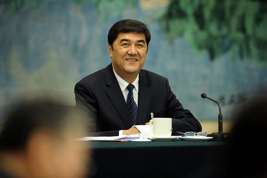 """A file photo of China's National Energy Administration director Nur Bekri. He is currently under investigation for """"suspected serious disciplinary and legal violations""""."""