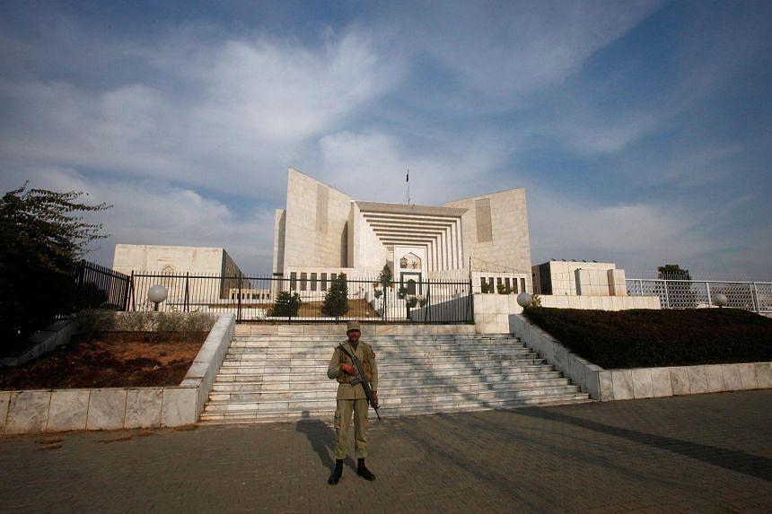 """A paramilitary soldier keeps guard outside the Supreme Court building in Islamabad, Pakistan. Former high court judge Shaukat Aziz Siddiqui had accused the ISI of being """"fully involved in manipulating judicial process""""."""