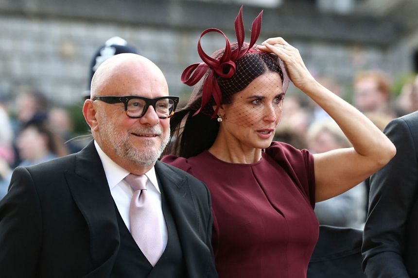 US actress Demi Moore arrives at St George's Chapel for Princess Eugenie's wedding to Mr Jack Brooksbank.