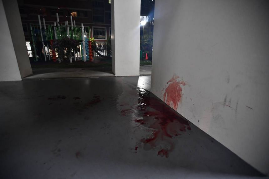 When The Straits Times went to the scene at 12.50am on Friday, a pool of blood could be seen at the foot of a pillar, with the trail of blood stretching across the void deck to the stone table and stools.