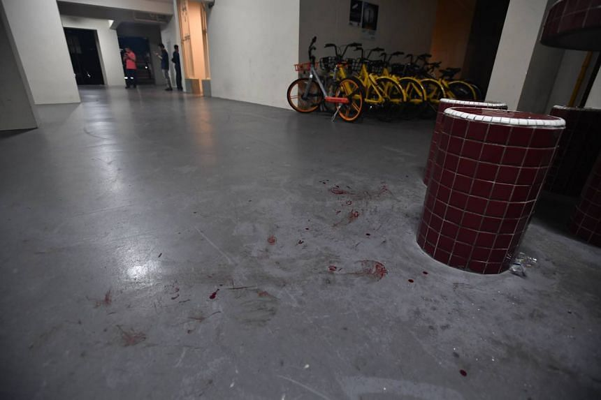When The Straits Times went down to the scene at 12.50am, a pool of blood could be seen at the foot of a pillar, with the trail of blood stretching across the void deck to the stone table and stools.
