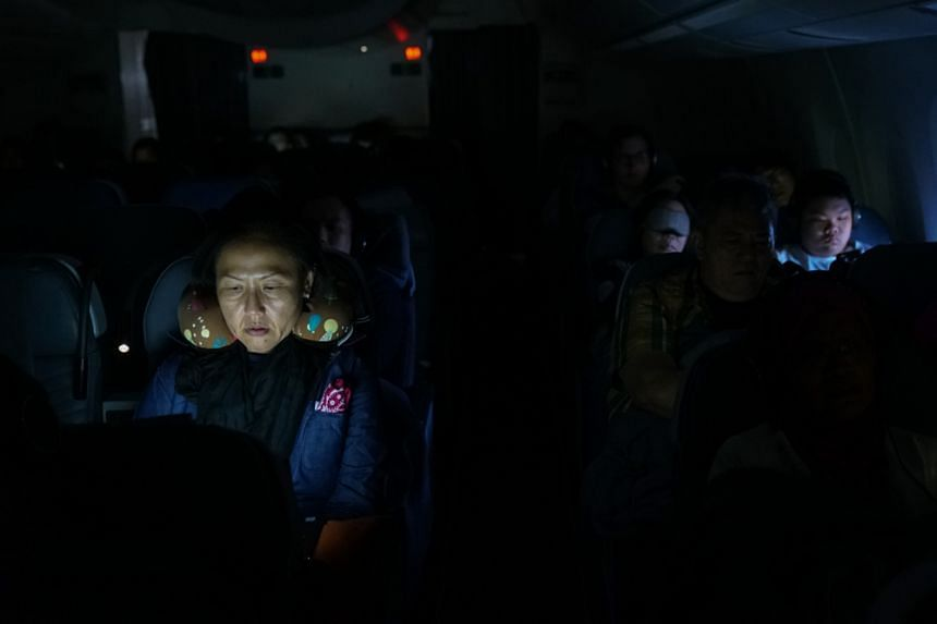 Passengers of SQ022 catching up on some sleep. New technology has made planes more fuel-efficient, prompting airlines to launch ultra-long-haul services.