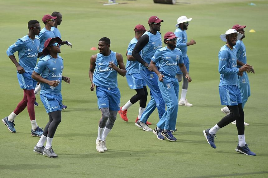 West Indies cricket captain Jason Holder (centre) runs with his teammates during a training session ahead of the second Test cricket match between India and West Indies, on Oct 11, 2018.