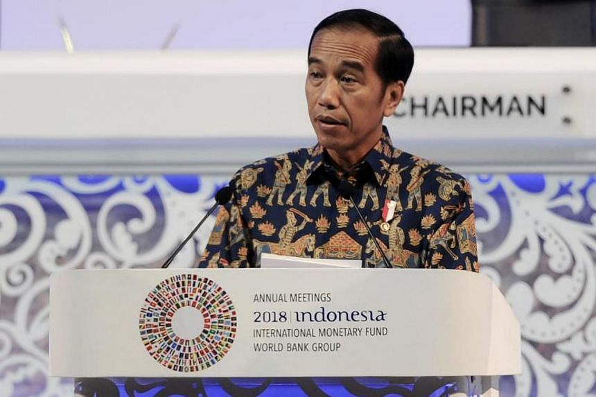 """Indonesian President Joko Widodo called on finance ministers and central bank governors to """"cushion the blows from trade wars, technical disruption and market turmoil""""."""