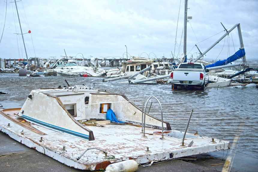 Hurricane Michael left a trail of damaged boats in a marina in Panama City, Florida, after it made landfall on Wednesday. It battered the city for nearly three hours and roads were made virtually impassable.