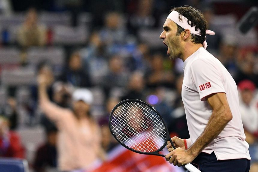 Federer reacts after winning against Kei Nishikori of Japan.