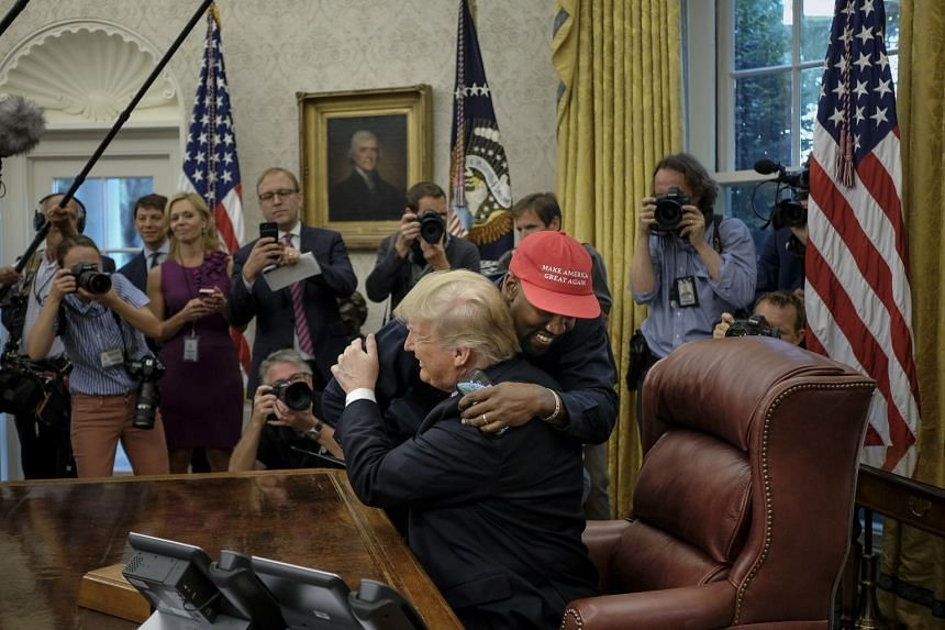 West hugs Trump in the Oval Office of the White House.