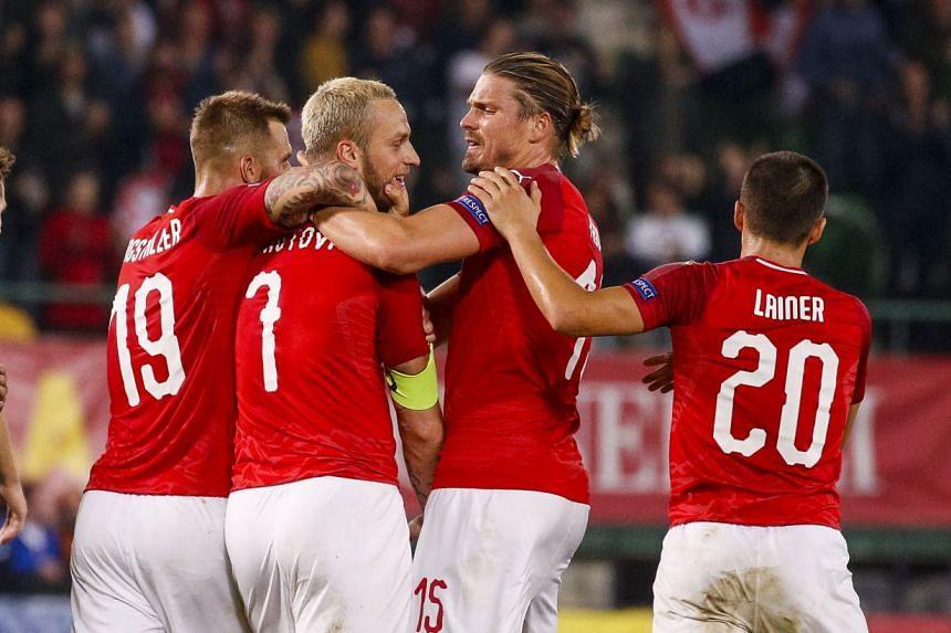 Austria's (from left) Guido Burgstaller, Marko Arnautovic, Sebastian Proedl and Stefan Lainer celebrate.scoring.