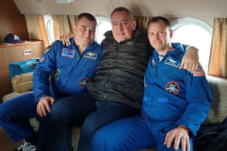 Roscosmos chief Rogozin posted a picture on Twitter of himself seated next to the two astronauts involved in the accident.