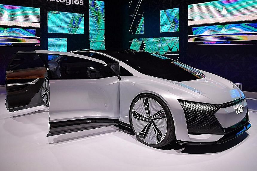 The Audi e-tron will arrive in showrooms by the third quarter of next year. The Audi Aicon (above) concept car is fully autonomous with no steering wheel.