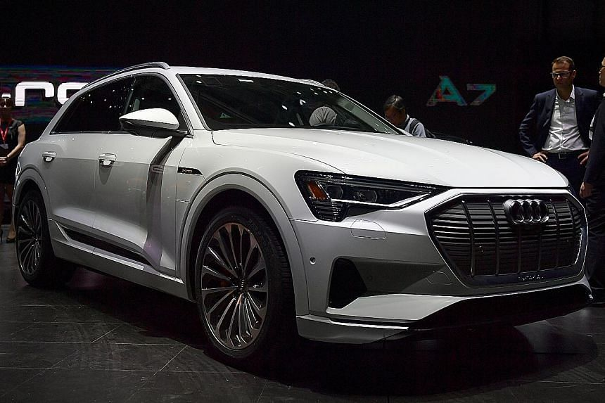 The Audi e-tron (above) will arrive in showrooms by the third quarter of next year. The Audi Aicon concept car is fully autonomous with no steering wheel.