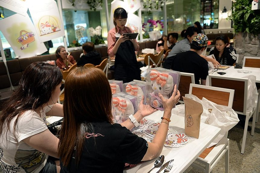 Fans received limited-edition merchandise at the 2016 opening of the Hello Kitty Orchid Garden cafe in Changi Airport's Terminal 3. Singapore's first Hello Kitty-themed cafe will shut its doors in February next year when its licence with Sanrio, whic