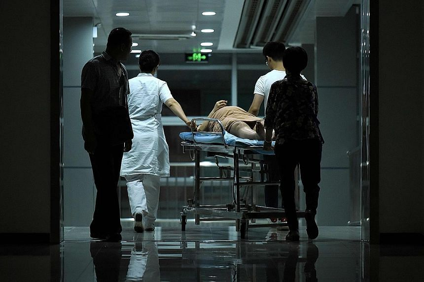 "A pregnant woman at a Beijing hospital. Millions of women each year may be putting themselves and their babies at unnecessary risk by having caesarean operations at rates ""that have virtually nothing to do with evidence-based medicine"", said the doct"
